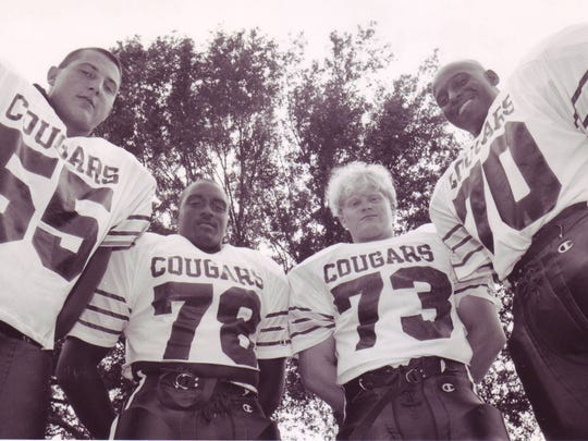 St. Thomas More's defensive front in 1993 consisted of Dwayne Viator (55), Doug Johnnie (78), John Marceaux (73) and Jon-Stephen Scott (70).