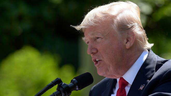 President Donald Trump announces that the U.S. will withdraw from the Paris climate change accord during a statement in the Rose Garden of the White House, Thursday, June 1, 2017, in Washington.