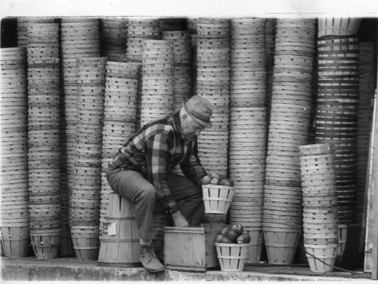Frank Tice sorts through apples for his famous cider