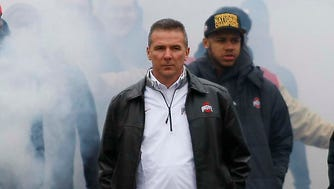 Ohio State Buckeyes head coach Urban Meyer takes the team out for the national championship celebration at Ohio Stadium.