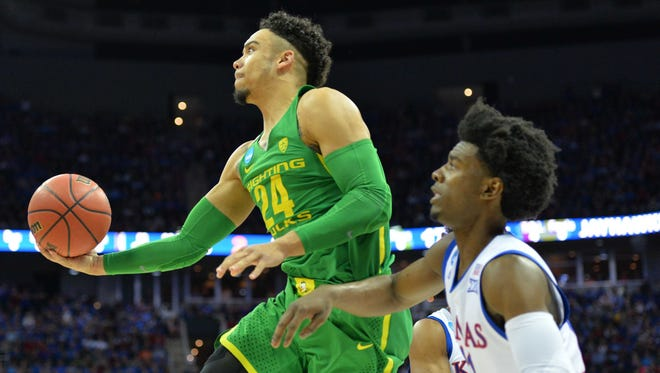 Mar 25, 2017; Kansas City, MO, USA; Oregon Ducks forward Dillon Brooks (24) goes up for a shot ahead of Kansas Jayhawks guard Josh Jackson (11) during the first half in the finals of the Midwest Regional of the 2017 NCAA Tournament at Sprint Center. Mandatory Credit: Denny Medley-USA TODAY Sports