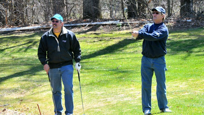 Mark Sickler, right, and Lee Rogalla, compete during Saturday's Wisconsin Valley Golf Association tournament at Ridges Golf Course in Wisconsin Rapids.