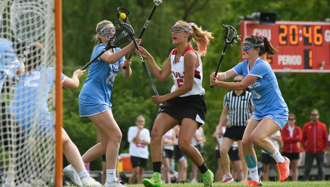 CVU's Natalie Durieux (16) looks to take a shot during the girls lacrosse game between the South Burlington Wolves and the Champlain Valley Union Redhawks at CVU High School on Wednesday afternoon June 6, 2018 in Hinesburg.
