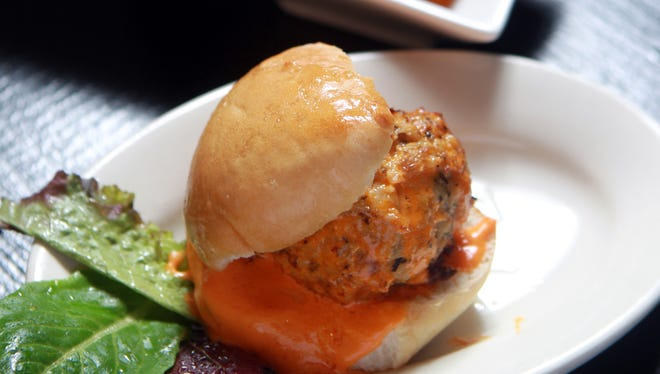 Chicken meatball with buffalo gravy slider and other dishes  available at Packhouse Meats, Newport.