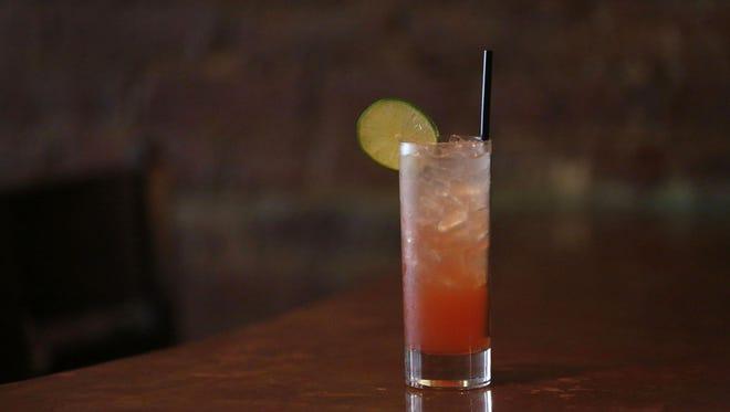 Paul Ritto makes a Plum Gin Rickey, a re-mixed version of a rickey, at 8 North Broadway in Nyack.