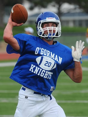 Luke Fritsch throws a pass during practice at McEneaney Field at O'Gorman High School on August 15, 2014.