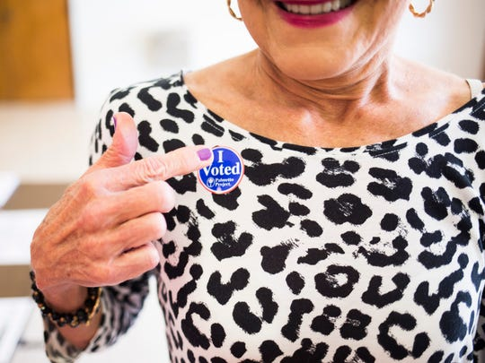 Brenda Rainey puts on a sticker after voting in the SC senate runoff election at McCants Middle School on Tuesday, April 25, 2017 in Anderson.