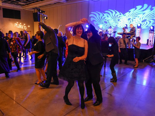 Guests dance to the music of the Fabulous Armadillos during the 2017 Catholic Charities Mardi Gras event.
