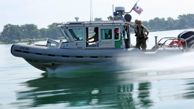 U.S. Customs and Border Protection agents patrol the Detroit River on the CBP Vessel Brian A. Terry shortly after its maiden voyage on Thursday, Aug. 29, 2013. The vessel was dedicated in a ceremony at Elizabeth Park in Trenton, Mich. and is named after agent Brian A. Terry, who was killed during an operation in Arizona in 2010. Terry was a native of Flat Rock, Mich.  BRIAN KAUFMAN/Detroit Free Press