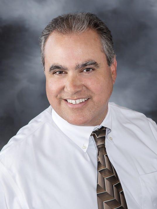 Dr Gus Gonzalez.jpg
