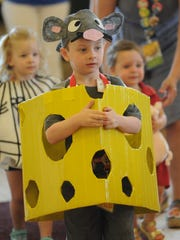 Rylan Martin, front, competes in the CALF costume contest