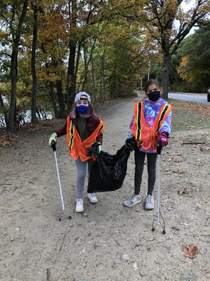 Students collect trash in Medford.