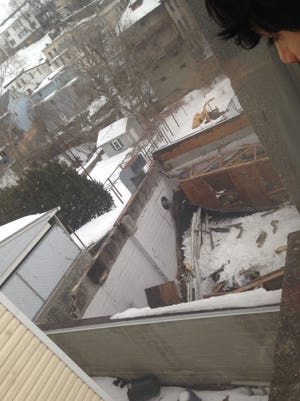 Heavy snow caved in a section of roof Saturday at AAA Nolan's Auto Collision in Ossining.