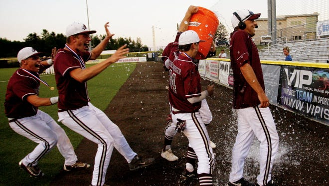 Menomonee Falls head coach Pat Hansen gets doused with water after his team won the 2016 state title game over Marquette at Kapco Park in Mequon.