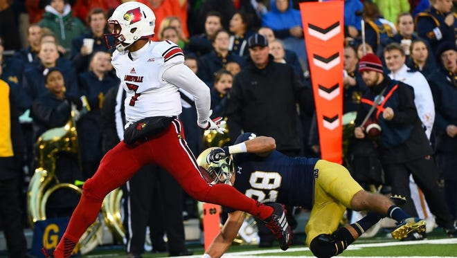 Nov 22, 2014; South Bend, IN, USA; Louisville Cardinals quarterback Reggie Bonnafon (7) rushes for a touchdown against Notre Dame Fighting Irish safety Austin Collinsworth (28) during the first quarter at Notre Dame Stadium. Mandatory Credit: Mike DiNovo-USA TODAY Sports