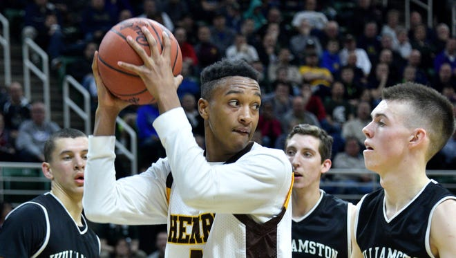 Detroit Henry Ford's Kavon Bey looks for a teammate to pass to under pressure from the Williamston defense in Henry Ford's semifinal triumph.