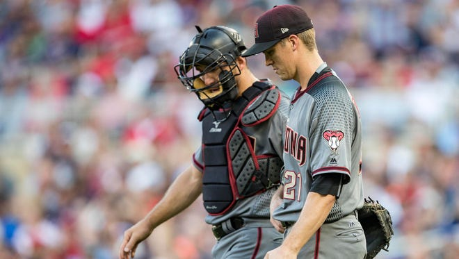 Arizona Diamondbacks starting pitcher Zack Greinke (21) talks to catcher Jeff Mathis (2) after the bases our loaded up in the first inning against the Minnesota Twins at Target Field.