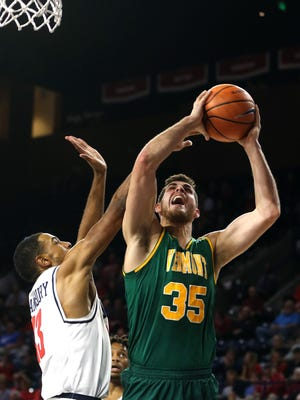 Payton Henson, right, scored a team-high 17 points in Vermont's 62-56 win at Harvard on Tuesday night.