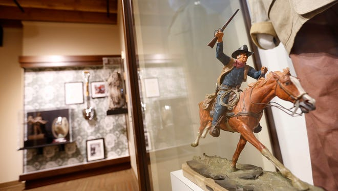 """A John Wayne sculpture called """"The Marshall,"""" by Western artist Harry Jackson, is on display , inside the John Wayne Birthplace Museum in Winterset. Museum officials said the sculpture was commissioned by and used on the cover of Time magazine in 1969, and was meant to portray Wayne's role of Rooster Cogburn in the movie """"True Grit."""""""