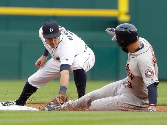 Houston Astros' Marwin Gonzalez beats the tag of Detroit Tigers second baseman Ian Kinsler for a double during the first inning of a baseball game Friday, July 29, 2016, in Detroit. (AP Photo/Carlos Osorio)