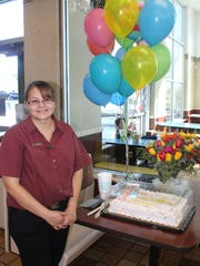Anabel Jimenez received cake, flowers and balloons in honor of receiving the distinguished Ray Kroc Award from the worldwide McDonald's.