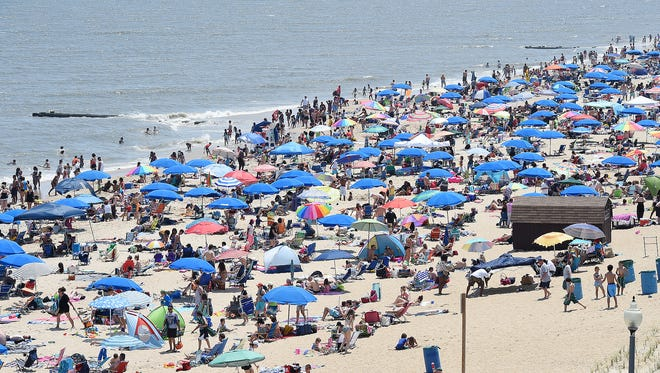 Crowds come to the beach as Memorial Day weekend starts the summer season in Rehoboth Beach on Saturday, May 28.