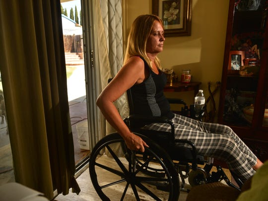 Marcy Majer wheels into the living room of her friend's home in Simi Valley as she recovers from West Nile virus and meningitis.