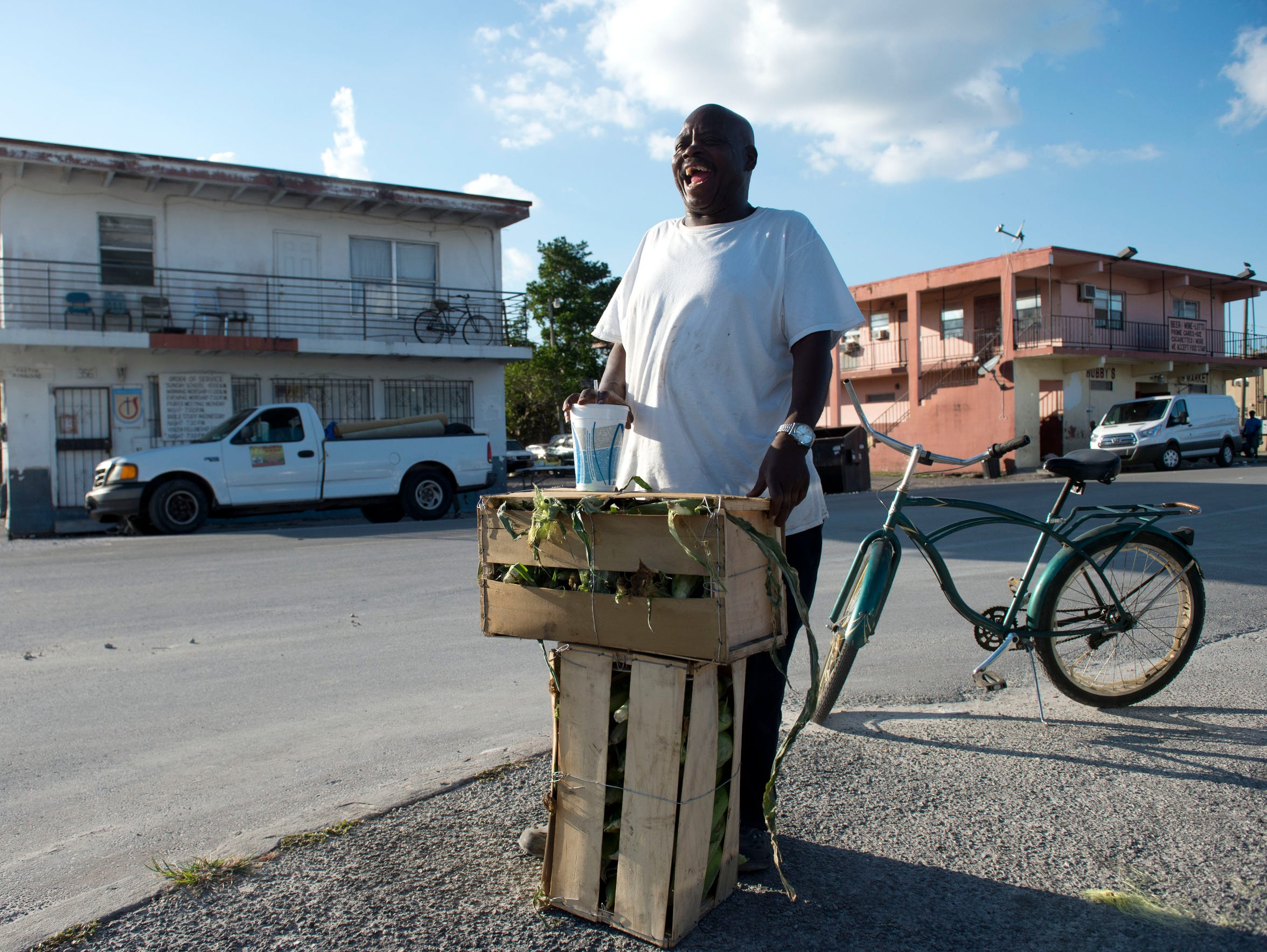 Tony Inman, of Belle Glade, sells sweet corn on a street