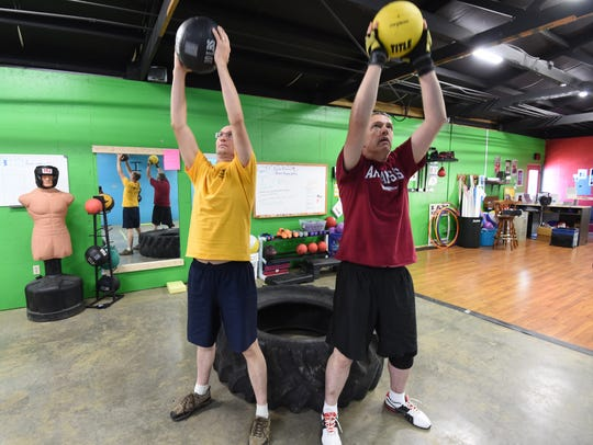 Bryce Parker, left, who doesn't have Parkinson's disease,