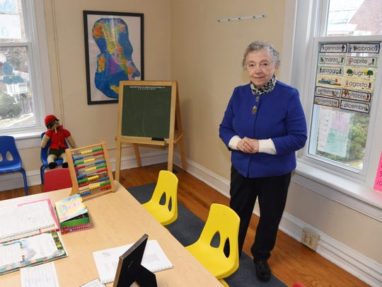 Vita Maria Mesnick, president, founder, and teacher at the Pirandello Institute of Language and Culture in the City of Poughkeepsie, pictured in one of the classrooms at the Institute.