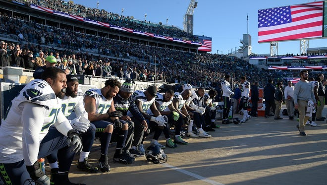 Seahawks players took a knee during the anthem before a December game.