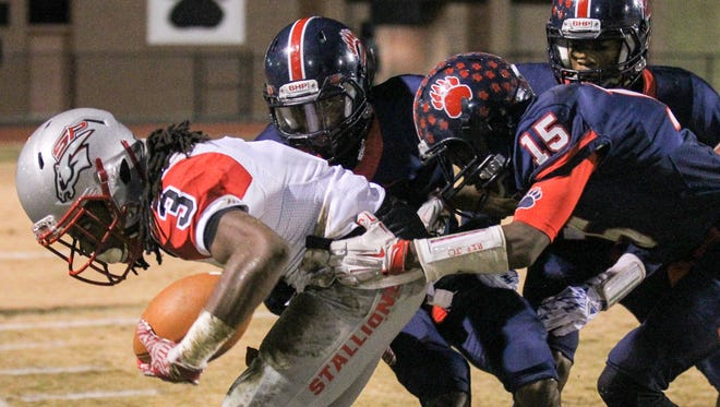 Belton-Honea Path's Dashon Stribling (15) tackles South Pointe junior Steven Gilmore during the fourth quarter, in the third round of the Class AAAA playoffs, on Friday at Belton-Honea Path High School in Honea Path.