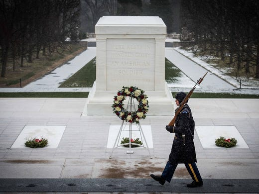 "A member of ""The Old Guard"" stays with the Tomb of"