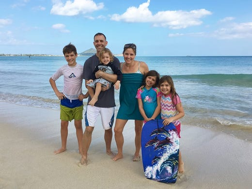 Maj. Shawn Campbell with his wife and four children.