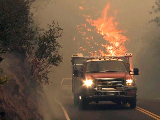 Cal Fire crews work to battle the Butte Fire in Amador