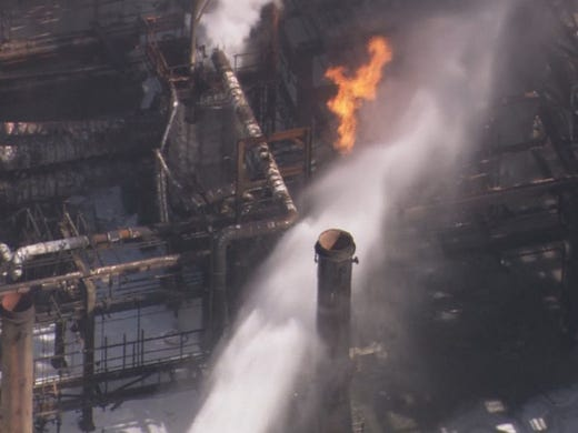 Air 11 over the scene of a refinery that exploded in