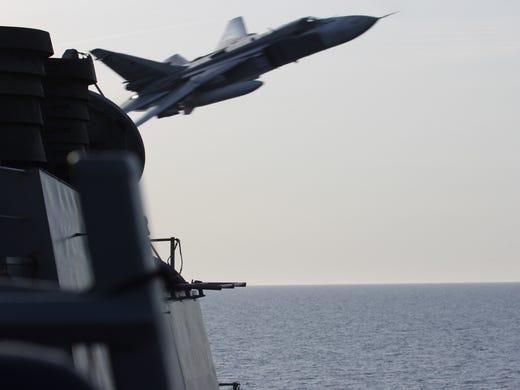 A Russian Sukhoi Su-24 attack aircraft makes a very-low