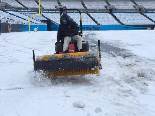 how to clear snow from turf field