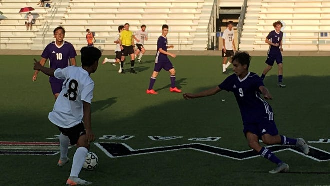 Topeka High senior Abel Lopez (18) tries to control the ball as Topeka West freshman Isaac Gonzalez-Talavera (9) and senior Jacob Jachens (10) defend in the Chargers' 2-1 win Tuesday.