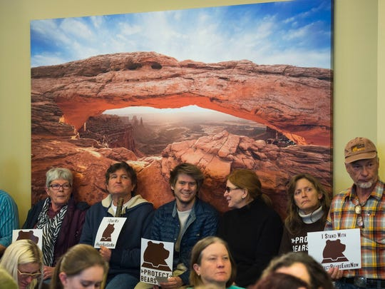 FILE - In this Monday, Dec. 19, 2016, file photo, Supporters of Utah's Bears Ears national monument hold signs during a news conference at the Utah State Capitol in Salt Lake City. Utah lawmakers have backed a resolution urging the state to be prepared to sue the U.S. government if Washington leaders don't start handing over federal land to the state. Members of a House natural resources committee on Friday, Feb. 24, 2017, approved the proposal, despite concern from one lawmaker that it could be costly and hurt the environment. (Steve Griffin/The Salt Lake Tribune via AP, File)/The Salt Lake Tribune via AP)