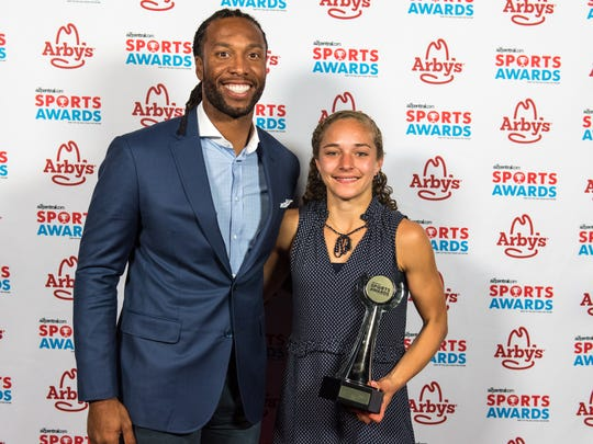 Larry Fitzgerald and Rio Rico's Allie Schadler after winning Girls Cross Country Athlete of the Year at the second annual azcentral.com Sports Awards on Sunday, April. 30, 2017 at ASU Gammage in Tempe, Ariz.