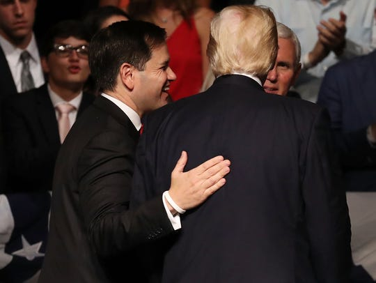 Sen. Marco Rubio, R-Fla., (R) and President Trump have