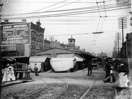 The exhibit shows everyday life in bygone Cincinnati, such us shoppers at the Sixth Street Market, located between Elm and Western Row (Central Avenue).