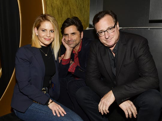 Candace Cameron-Bure, John Stamos, and Bob Saget attend