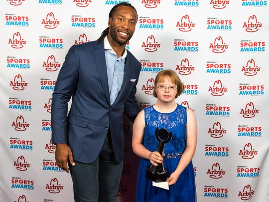 Larry Fitzgerald and Sandra Day O'Connor's Amy Bockerstette after winning the Best Moment of the Year award at the second annual azcentral.com Sports Awards on Sunday, April. 30, 2017 at ASU Gammage in Tempe, Ariz.