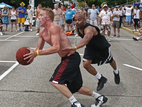 Taylor Roos drives past Jeff Ivy for two points in a semi-final game in the 6 Foot Competitive division during the 13th annual 2011 Oregon National Guard Hoopla, in front of the Capitol, on Sunday, July 24, 2011. He has been posting scores for all fifteen years of the event.