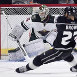 Los Angeles Kings right wing Dustin Brown shoots the puck as Wild goalie Darcy Kuemper defends the goal during the first period Thursday, Jan. 21, in Los Angeles.
