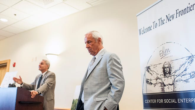 Coach Roy Williams waits for his introduction at Asheville-Buncombe Technical Community College on Friday. An affordable housing complex for teachers that is a joint effort between Asheville City Schools, Buncombe County Schools, Eblen Charities, Buncombe County and the State Employees' Credit Union Foundation was announced after a luncheon Friday.