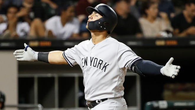 Aug 6, 2018; Chicago, IL, USA; New York Yankees second baseman Gleyber Torres (25) reacts as he crosses home plate after hitting a solo home run against the Chicago White Sox during the eight inning at Guaranteed Rate Field.