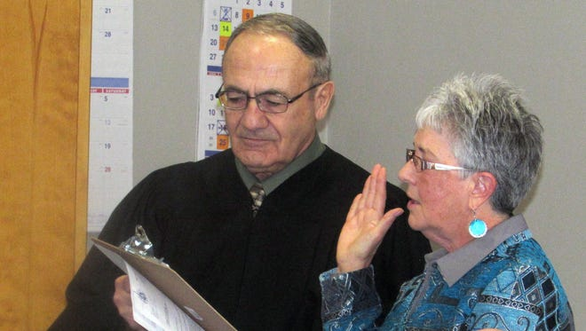 Horseheads Village Justice Louis Tarentelli administers the oath of office to new Mayor Louise McIntosh during Monday's board of  trustees meeting.